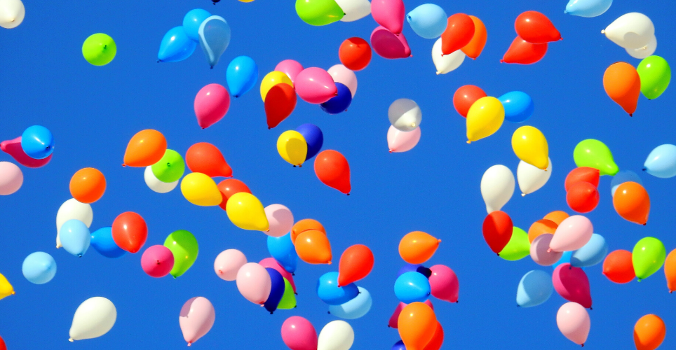 Colorful balloons floating in the sky