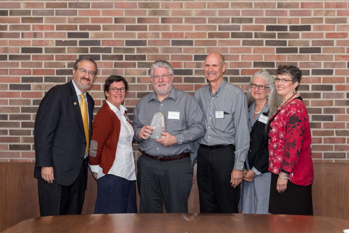 From left President Schlissel, Victoria K. Green, Chris Mueller, Jeff Dils, MaryBeth Steunkel, Monika R. Dressler