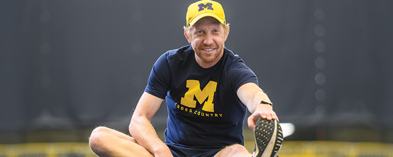 Kevin Sullivan, Men's head coach, cross country, stretching