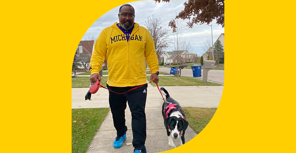 Dr. Steven Gay, Asst. Dean for Admissions, Medical School, walking his dog Coco.