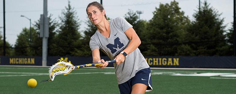 U-M Women's Lacrosse coach playing lacrosse