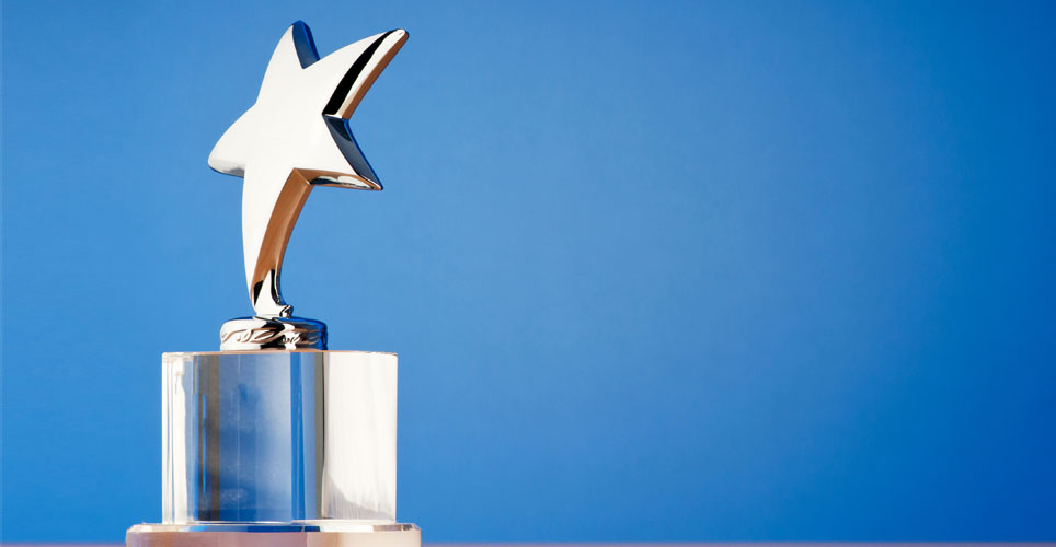 award with a star on top