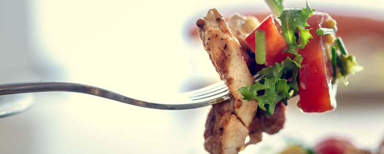 Chicken and veggies on a fork