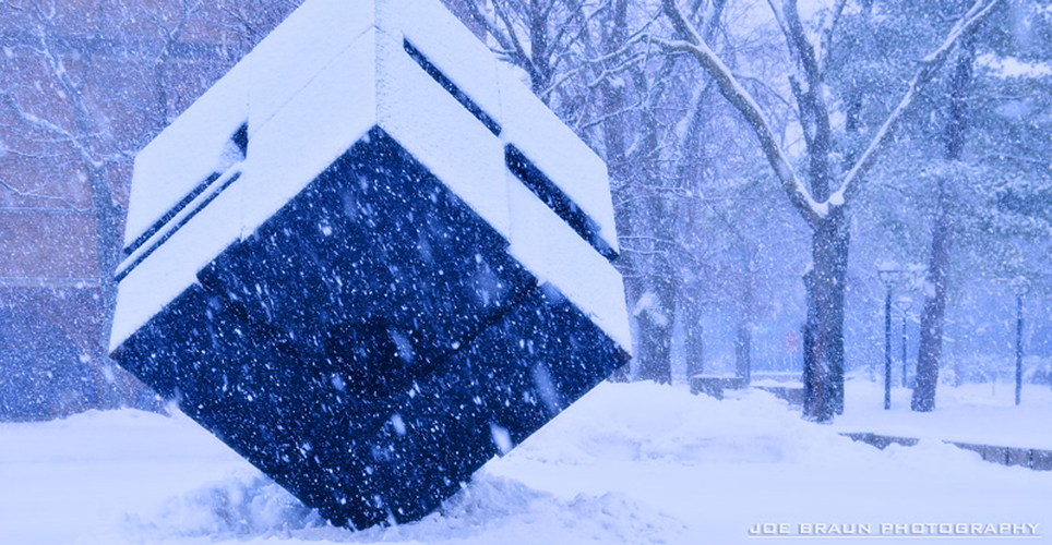 Cube sculpture on the University of Michigan campus covered in snow