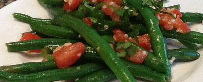 green beans and tomatoes on a plate