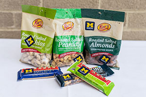 Assorted bags of nuts and snack bars