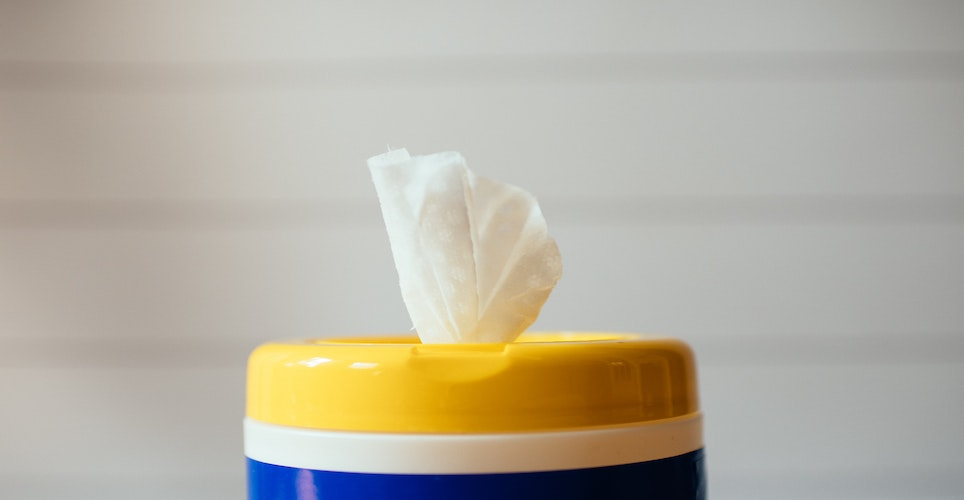 yellow blue and white plastic container of disinfectant wipes