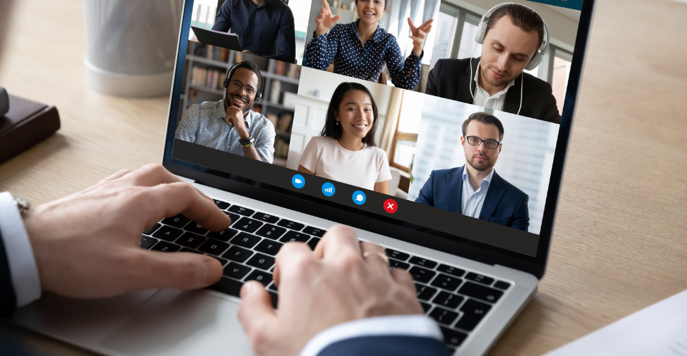 Person in an online meeting with six others on the screen.