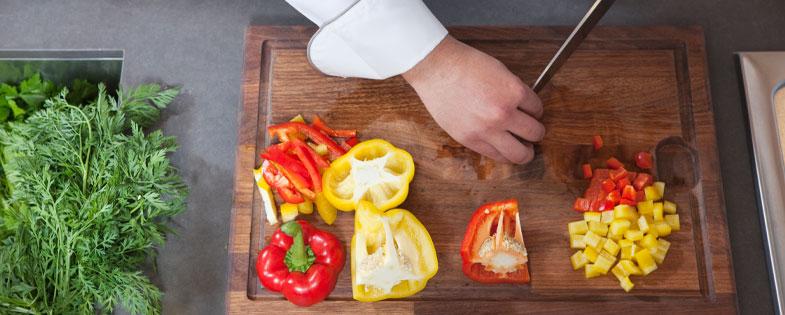 man chopping bell peppers