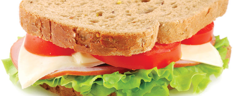 turkey sandwich on wheat bread with lettuce and tomato