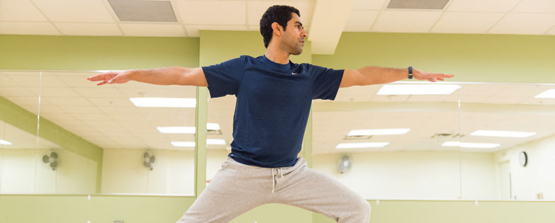 man holding yoga pose