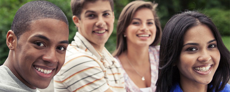 4 smiling teens