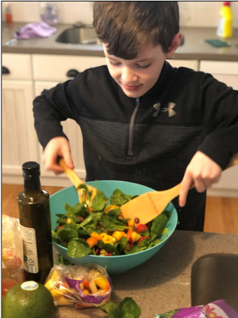 student making a salad at home