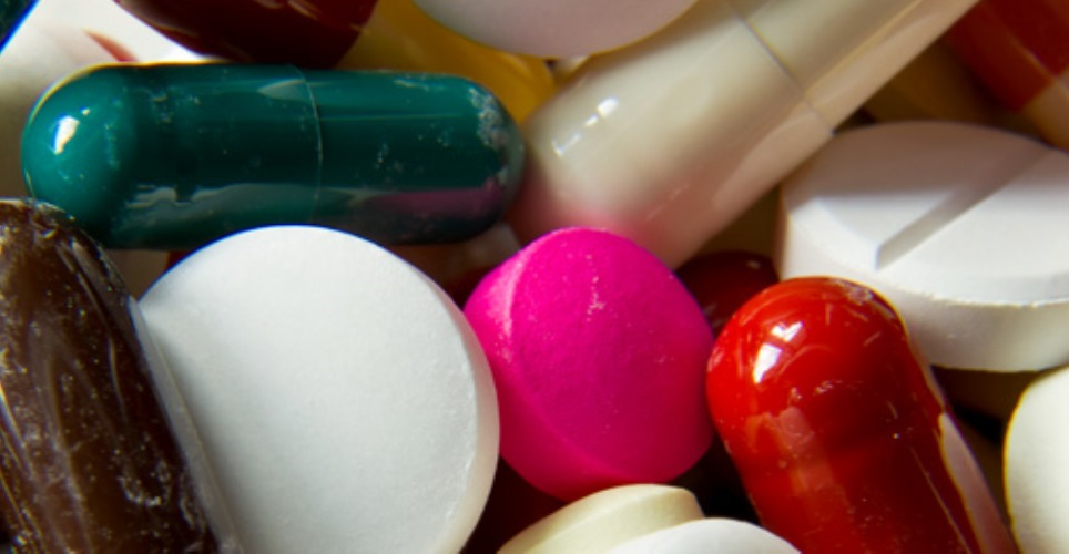 A jumble of multicolored pills of different sizes