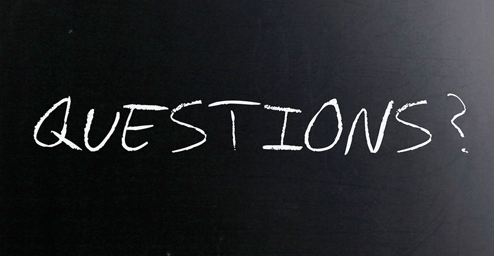 "Blackboard with the word ""questions"" written in chalk"