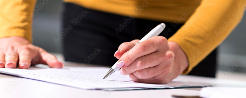 A person writing on a document