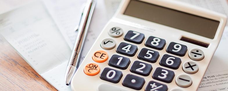 Planner, pen and calculator