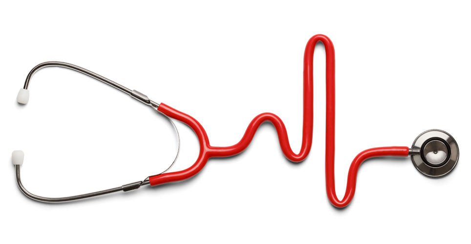 Close up of a stethoscope with red tubing that forms a heart rhythm