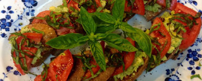 tomatoes on toast with basil on top