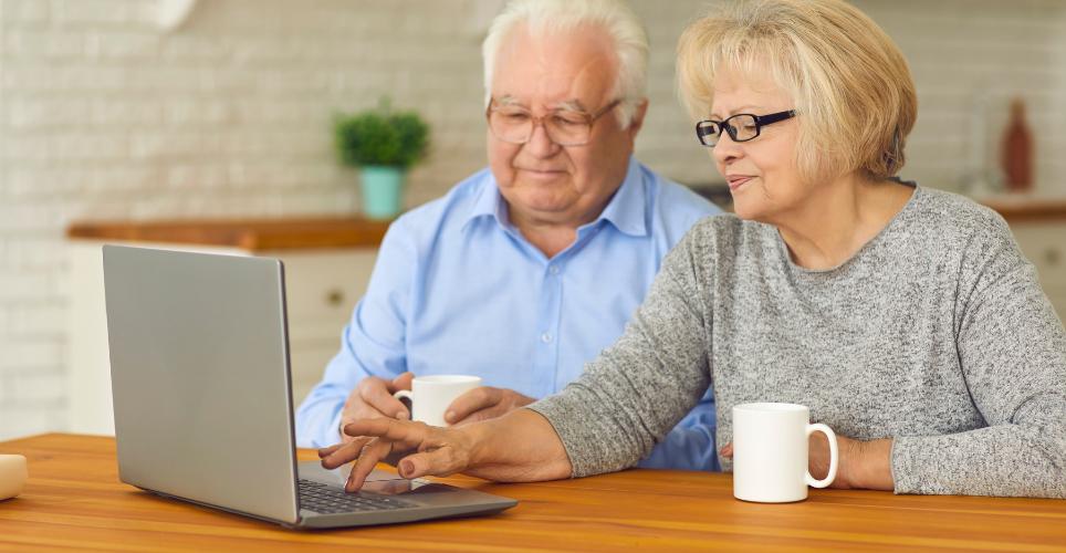elderly couple chatting on on computer