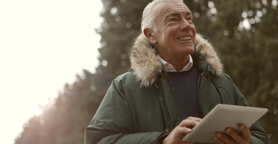 Man outdoors with tablet