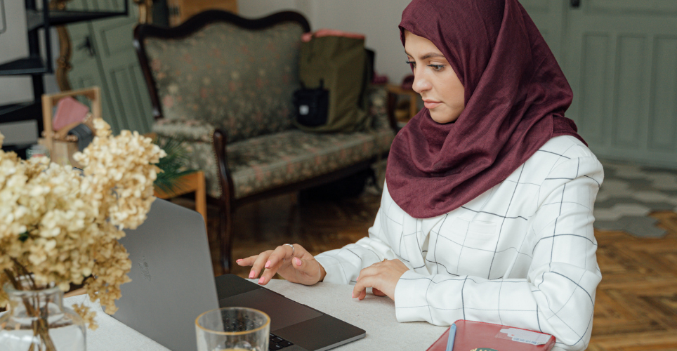 Woman on laptop sitting at desk