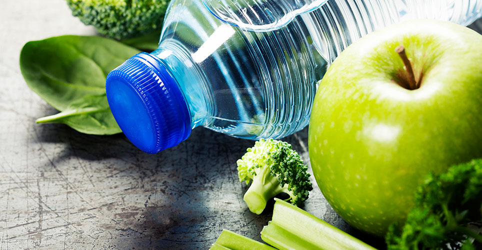 Water bottle with apple and vegetables